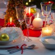 Preparing for Christmas Eve at beautifully decorated table — Stock Photo #35626901