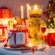 Candlelight and gifts all around the Christmas table — Stock fotografie