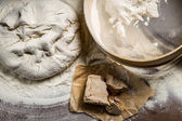 Homemade pizza dough made from yeast and flour — Stock Photo