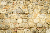 Medieval wall built of stone — Stock Photo