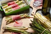 Preparation asparagus with prosciutto ham — Stock Photo