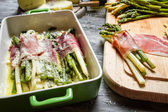 Closeup of asparagus rolled in ham and cheese — Stock Photo