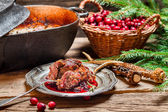 Venison with cranberry sauce and rosemary — Stock Photo
