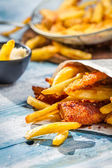 Closeup of Fish & Chips served in the newspaper — Stock Photo