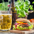 Stock Photo: Homemade burger and a cold beer