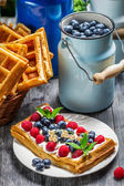 Waffles with berry fruit and whipped cream — Stock Photo