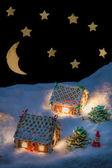 Casita de jengibre en invierno con las estrellas — Foto de Stock