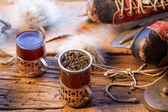 Hot tea brewed in the old style — Stock Photo