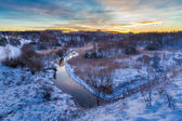 Sunrise over the winter valley — Stockfoto