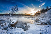 Old boat on the lake covered with snow in winter — 图库照片