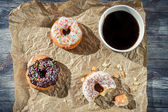 Break at work with coffee and donuts — Stock Photo