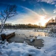 Old boat on the lake covered with snow in winter — Stok fotoğraf