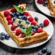 Closeup of waffles with fresh berry fruit — Stock Photo #38592683