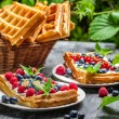 Waffles with fresh collected berry fruit — Stock Photo #38592687