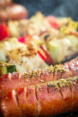 Closeup of skewers with vegetables on the grill — Stock Photo