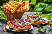 Waffles with fresh collected berry fruit — Stock Photo
