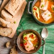 Fresh fish soup served with bread — Stock Photo