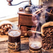 Stockfoto: Hot coffee with scent of cinnamon