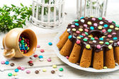 Decorating traditional easter cake with candies — Stock Photo