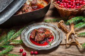 Roast venison straight from the hunt with cranberry sauce — Stock Photo