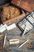 Homemade cigarettes made with tobacco — Stock Photo