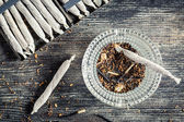 Closeup of cigarettes and ashtray — Stock Photo