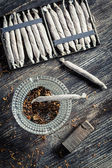 Closeup of cigarettes, ashtray and lighter — Stock Photo