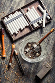 Smoked a wooden pipe with cigarettes — Stock Photo