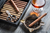 Cigar in ashtray and cognac — Stock Photo