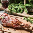 Stock Photo: Cutting freshly baked venison