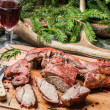 Fresh venison around with antlers and spruce — Stock Photo #39917691