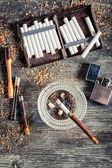 Cigarettes, ashtray and a smoking pipe — Stock Photo