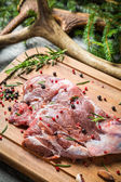Marinating fresh meat with the rosemary — Stock Photo