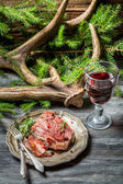 Fresh piece of venison served with red wine — Stock Photo