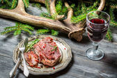 Venison served in the forester lodge with wine — Stock Photo