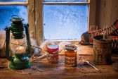 Hot tea in a small house at winter — Stock Photo