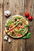 Freshly baked pizza with black olives — Stock Photo