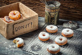 Tasting freshly baked donuts — Stock Photo