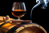 Aroma of Cuban cigars and cognac on black background — Stock Photo
