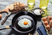 Egg on a pan served with bread — Stock Photo