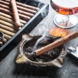 Taste of cognac and cigar fuming — Stock Photo #40944145