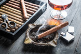 Taste of cognac and cigar fuming — Stock Photo