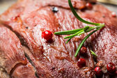 Closeup of freshly baked meat with rosemary — Stock Photo