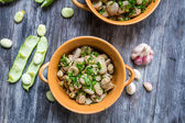 Two bowl with broad beans, parsley and garlic — Stock Photo