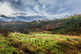 Rain clouds over a mountain valley in Scotland — Стоковое фото
