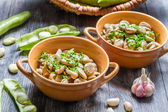 Closeup of broad beans with parsley and garlic — Stock Photo