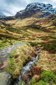 Mountain footpath leading to the peak in Scotland — Stock Photo