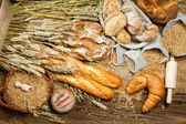 Various kinds of fresh baked bread with grain — Stock Photo