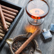 Cigar in ashtray, lighter and cognac — Stock Photo