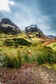 Green hills and snowy peaks in Scotland — Stock Photo